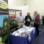 Chairman Bill Payne and Janice Gardner speaking to a fellow exhibitor