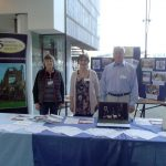 Anne Morgans, Virginia Jones and Bill Payne at the stand