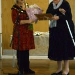 Ann receiving her award from Council Leader Jennifer Davies
