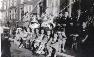 124: Residents of Evelyn, Winifred & Christopher Roads celebrating the Festival of Britain 1951.  We are missing names for numbers 2 to 7 in this photograph.
