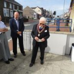 Councillor Mike Harvey looks on as Leader of the Council Arthur Davies gives his speech